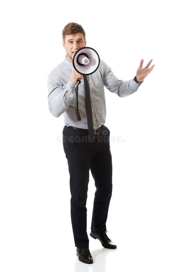 Businessman shouting through megaphone. royalty free stock image
