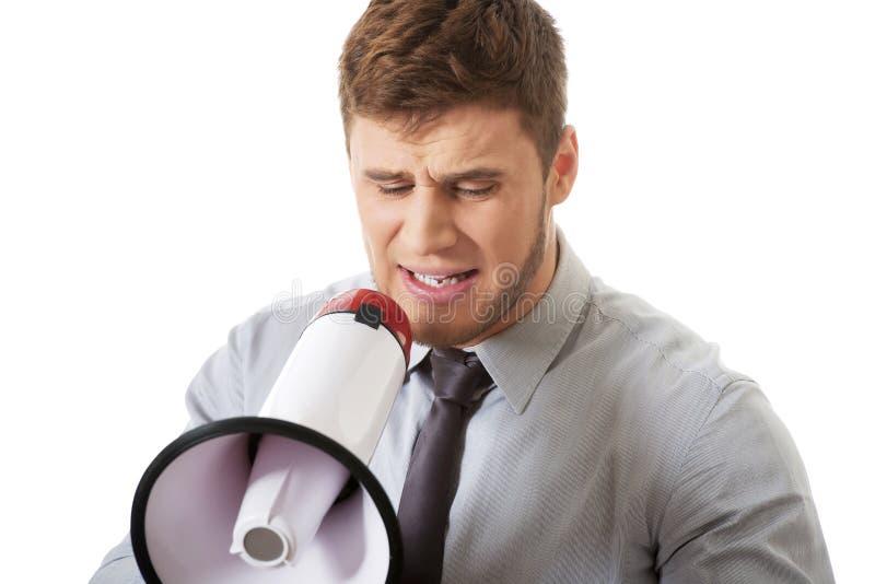 Businessman shouting through megaphone. royalty free stock photo