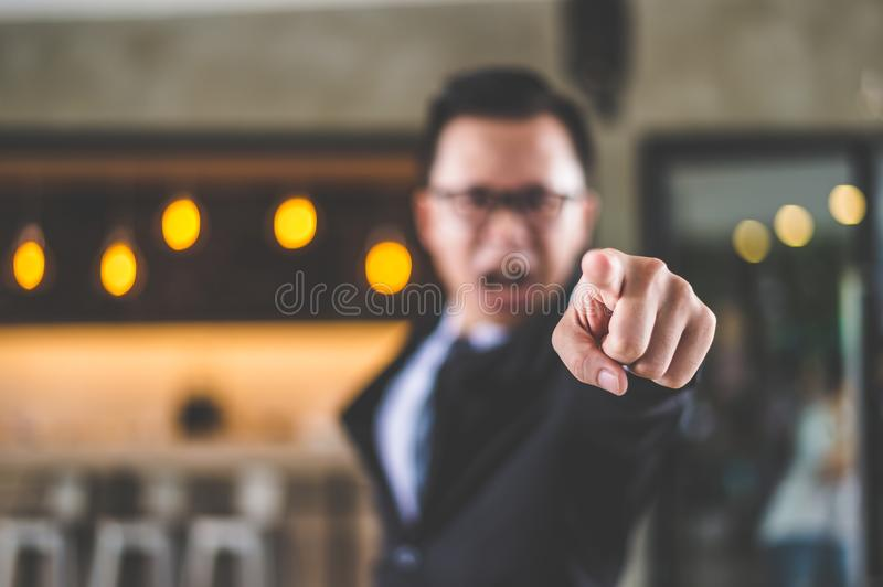Businessman shouting and pointing finger to camera. Businessman shouting and pointing finger to camera because he is very angry from Sales reports and financial stock photo