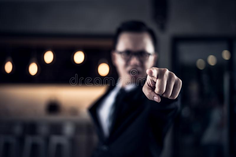 Businessman shouting and pointing finger at you because he is very angry from Sales reports decreased. Businessman shouting and pointing finger at you because he stock images
