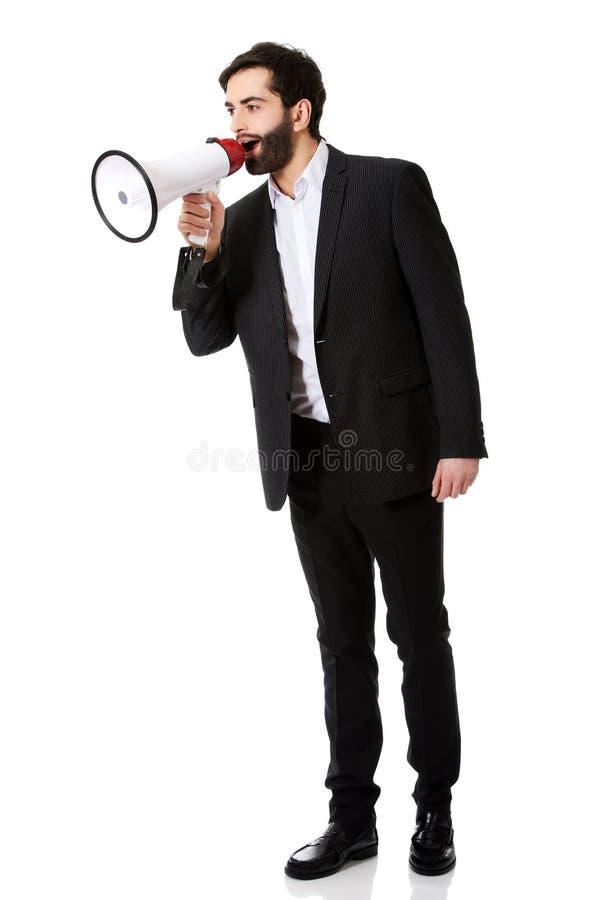 Businessman shouting using a megaphone. royalty free stock photos