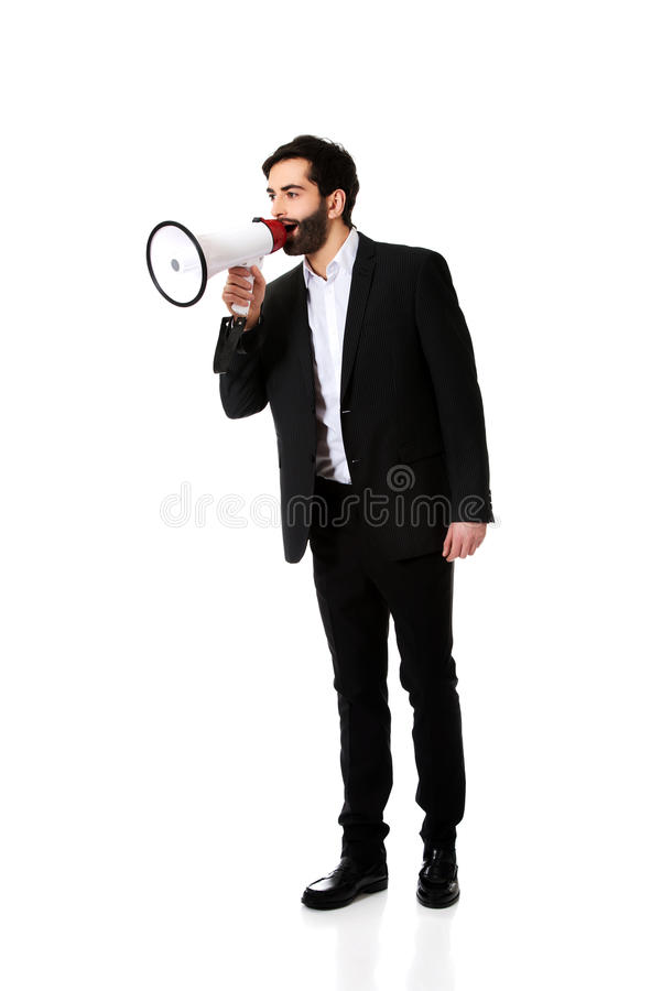 Businessman shouting using a megaphone. royalty free stock photography