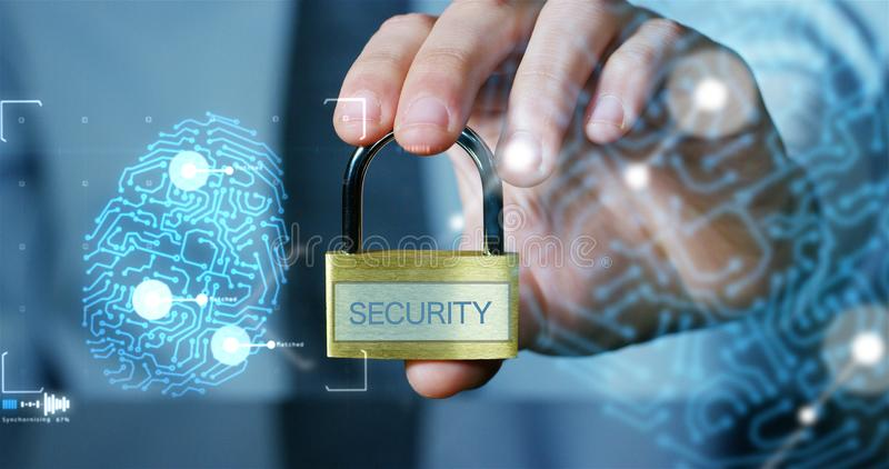 Businessman show a padlock with keys in safe sign with futuristic holographic about services and safety.concept of:password,Protec stock photo