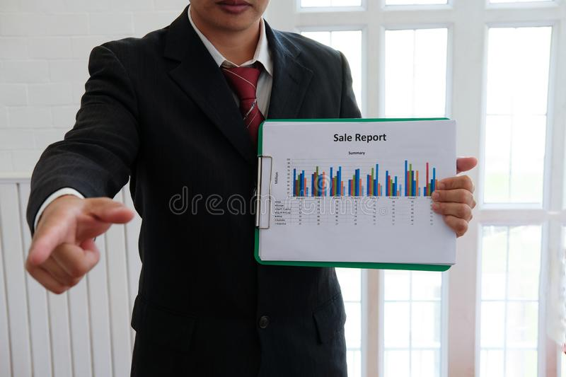 Businessman shows analytic financial accounting market chart graph report summary, business statistics performance concept royalty free stock photography
