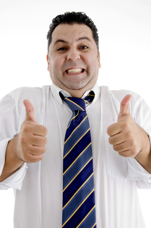 Businessman showing approved hand gesture stock image