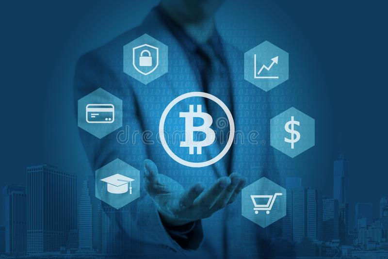 Businessman is showing bitcoin graphic on hands. Concept of blockchain technology royalty free stock images