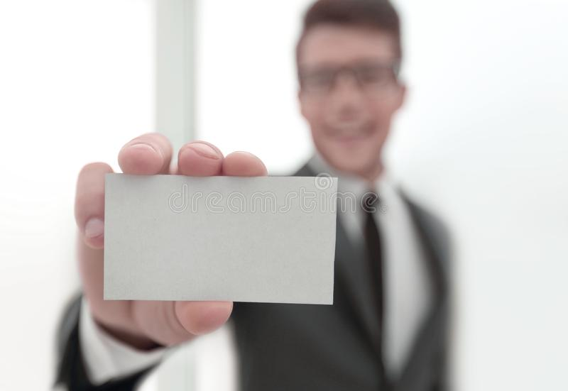 Businessman showing a blank business card royalty free stock photo
