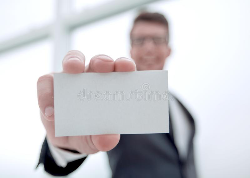 Businessman showing a blank business card stock photography