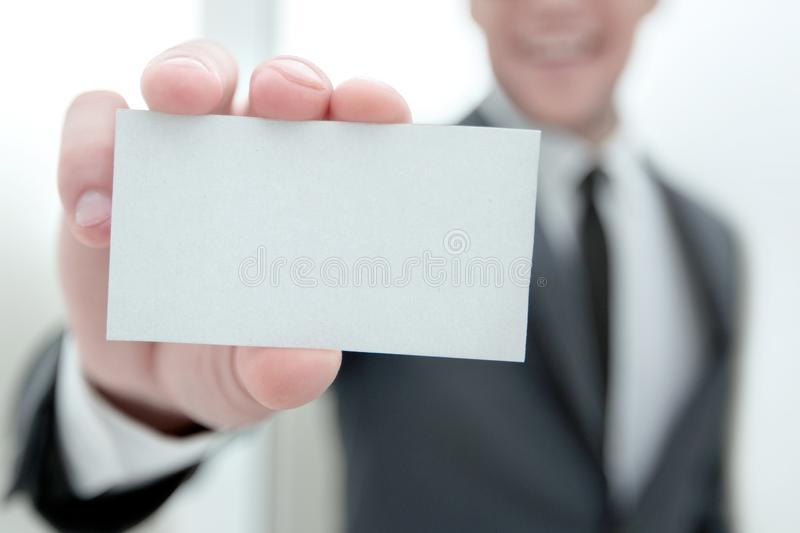 Businessman showing a blank business card stock photos