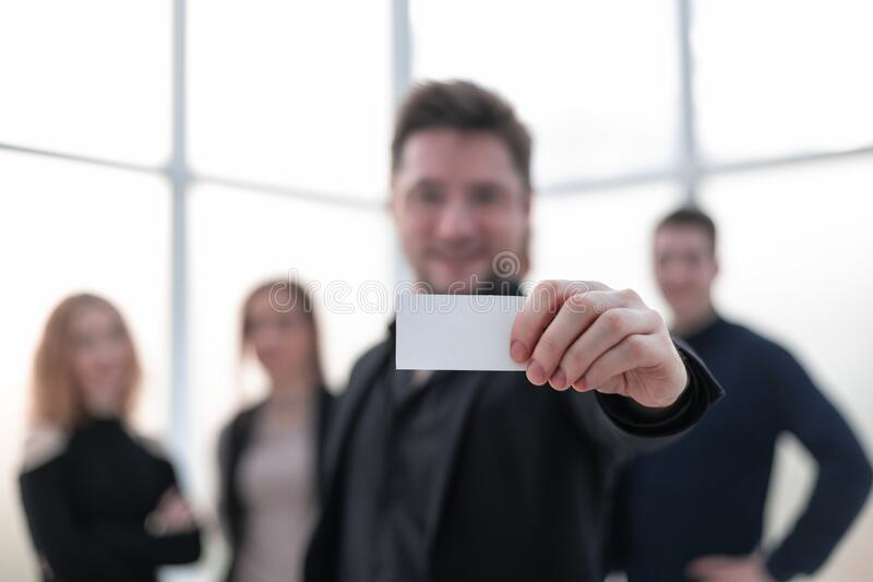A handsome businessman showing a blank piece of paper. Close-up stock photography
