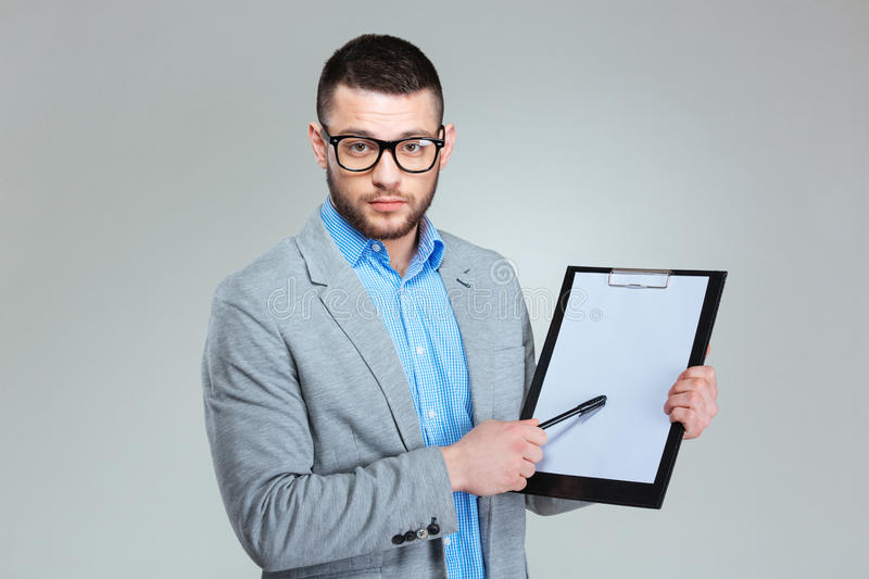 Businessman showing blank clipboard royalty free stock photography