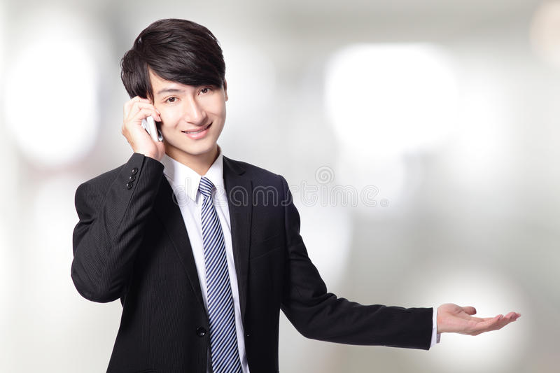 Download Businessman Showing Copy Space With Phone Stock Photo - Image: 29712266