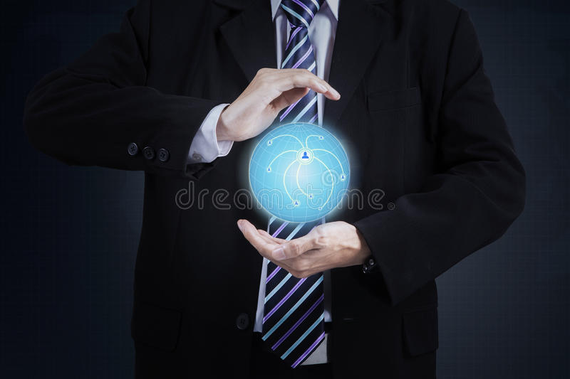 Businessman showing 3d globe stock photography