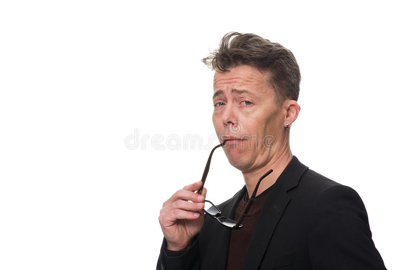 Businessman Showing Dismissive Shrug Against White. Close up Middle Age Businessman, Holding his Eyeglasses, Showing Dismissive Shrug While Looking at the Camera royalty free stock image