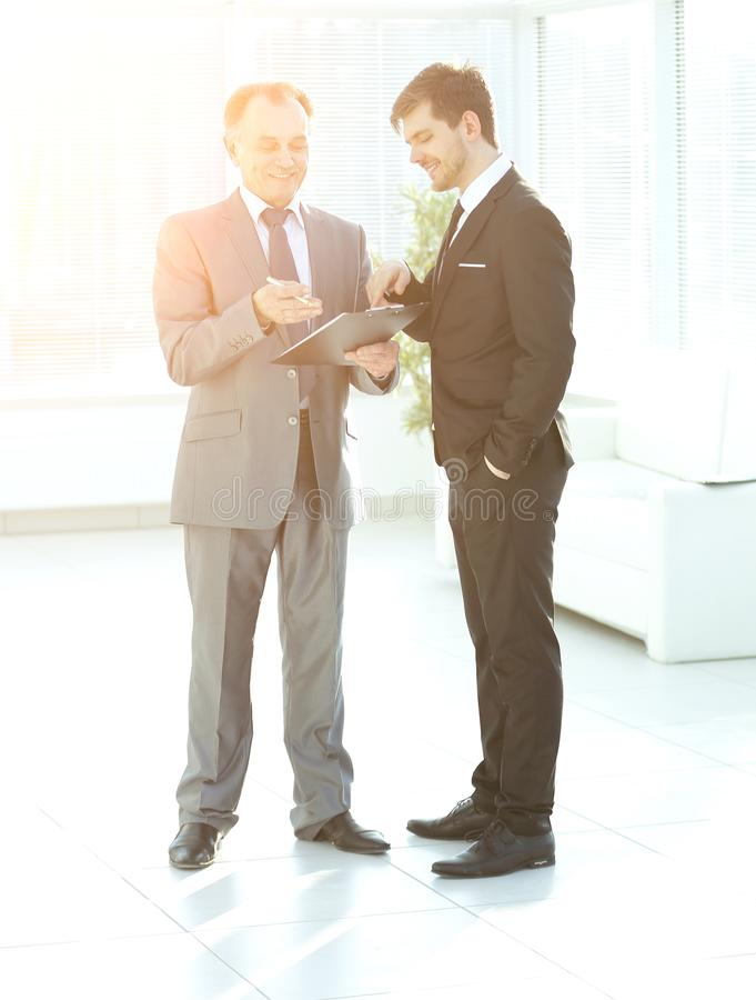 Businessman showing a document to his colleague. Photo with copy space royalty free stock photo