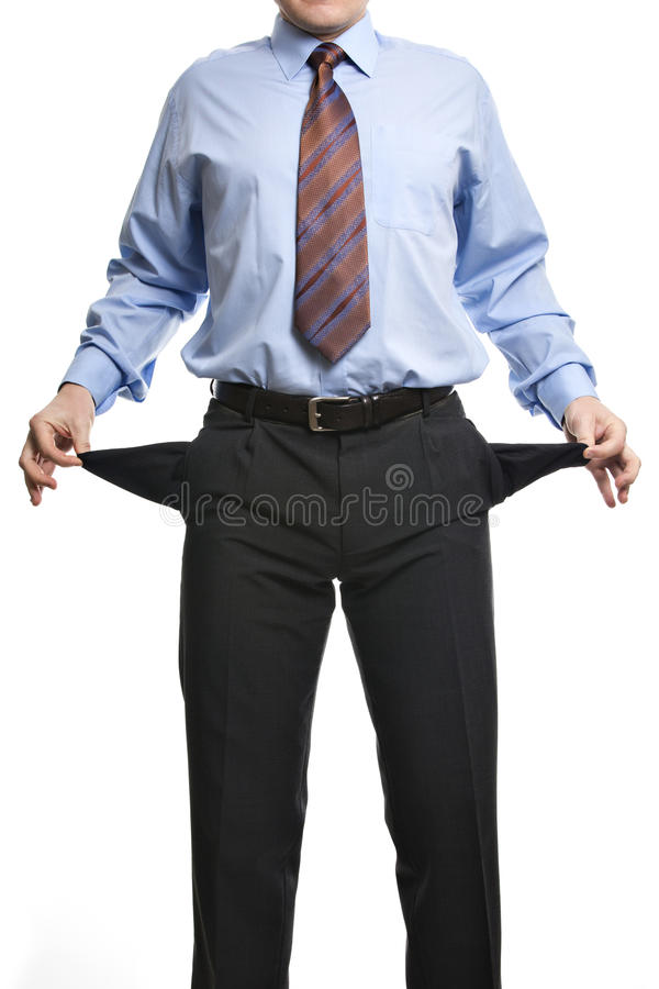 Businessman showing empty pockets. Concept for bankruptcy, poverty or penniless. Isolated on white background royalty free stock image
