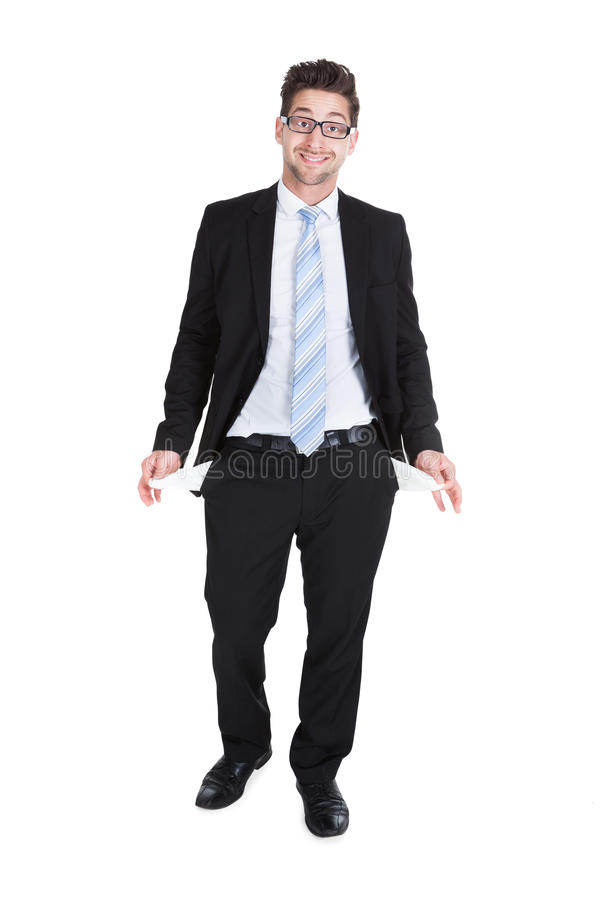 Businessman showing empty pockets royalty free stock image