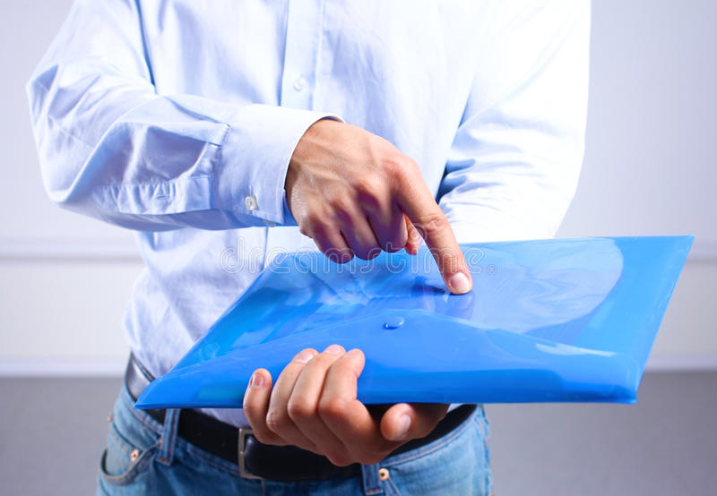 Businessman showing a folder with important documents.  royalty free stock photos