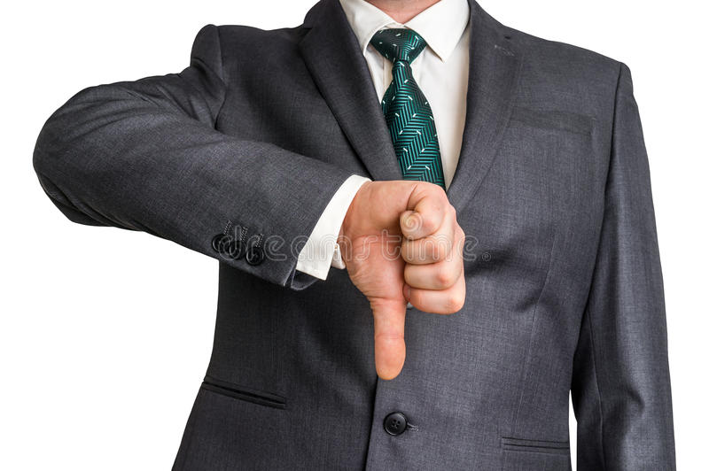 Businessman showing gesture with thumb down stock photos