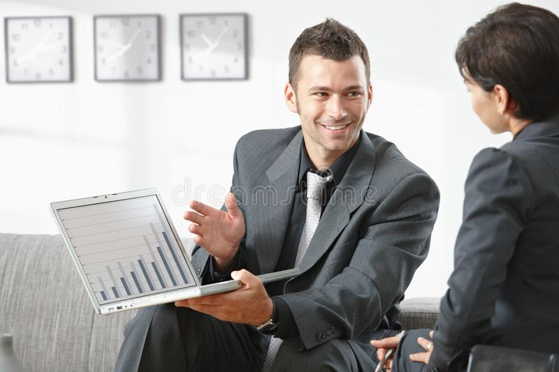 Businessman showing grapth on computer stock photos