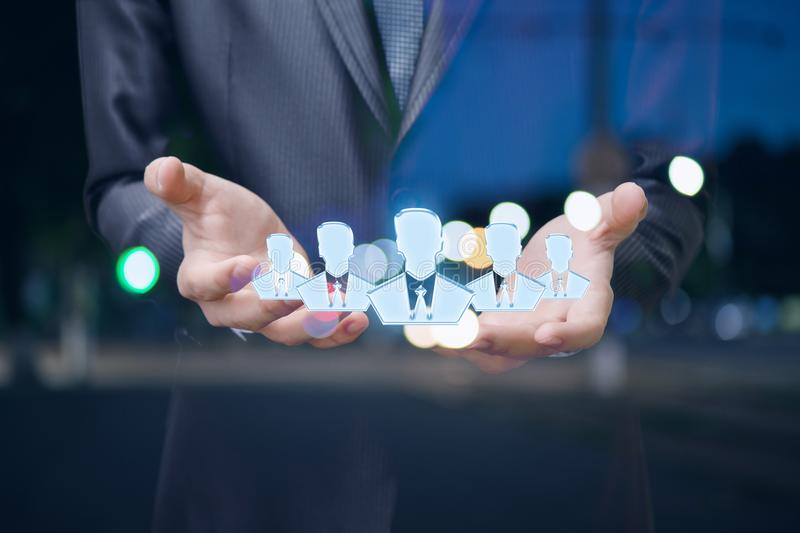 Businessman showing the hands of a group of people. stock photo
