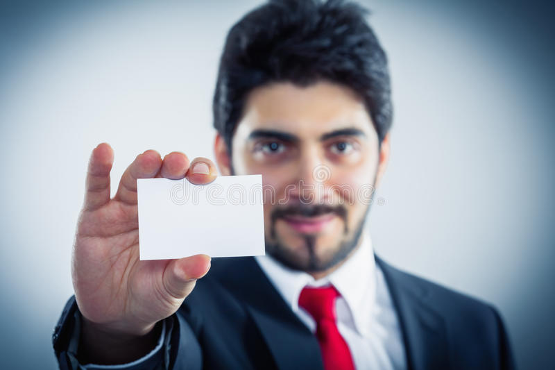 Businessman showing his business card royalty free stock photography