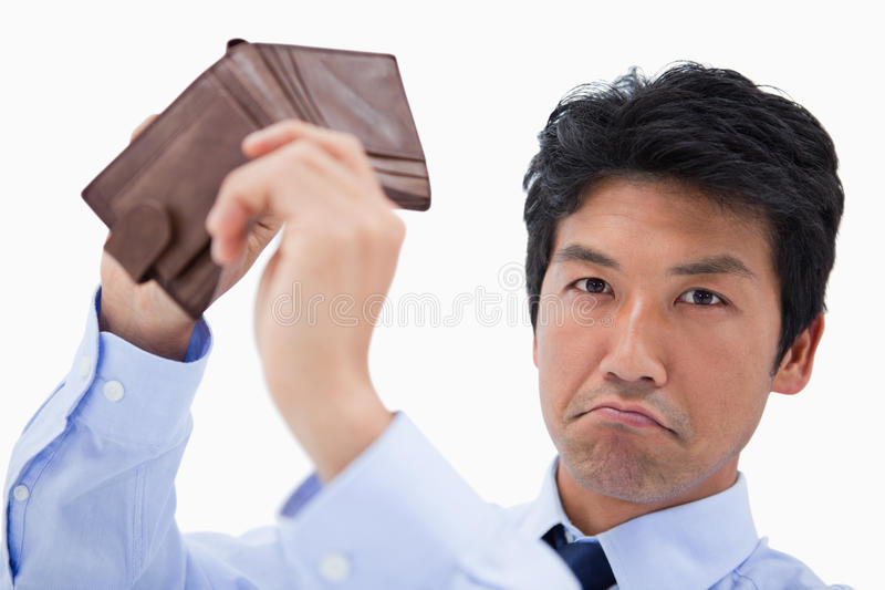 Businessman showing his empty wallet. Against a white background royalty free stock photography