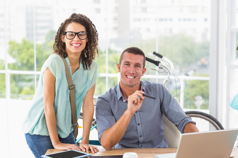 Businessman showing his work on laptop. To an attentive colleague stock photo