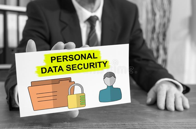 Personal data security concept on an index card. Businessman showing an index card with personal data security concept royalty free stock images