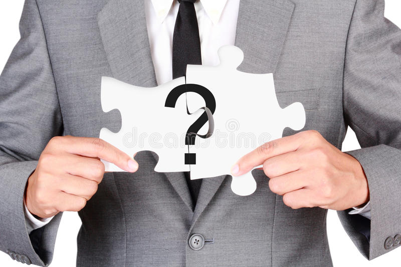 Businessman showing jigsaw connect create question mark. Concept question mark jigsaw connected businessman showing jigsaw connect create people connection royalty free stock photography