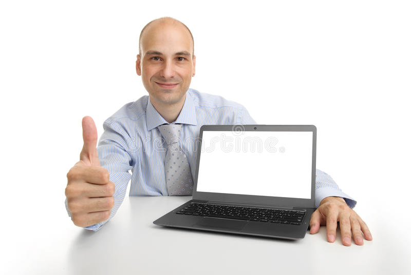 Businessman showing laptop computer with blank screen stock photos