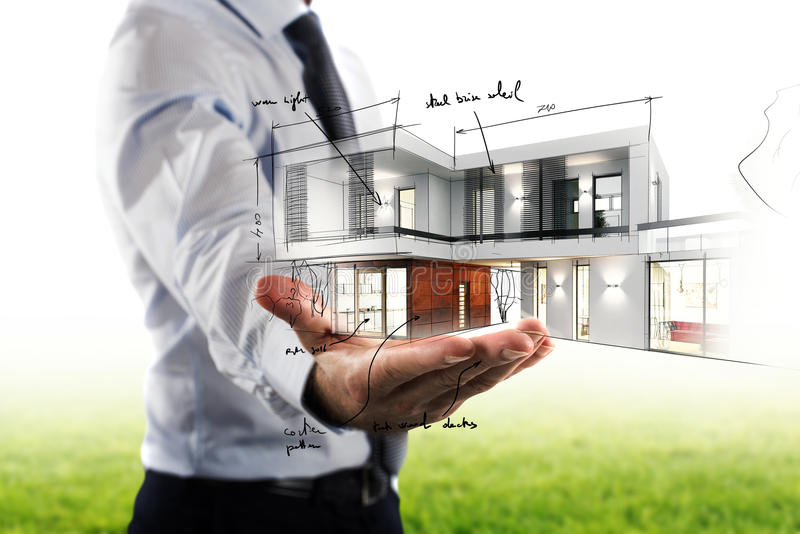 Businessman showing a modern office project. In hand royalty free stock photos