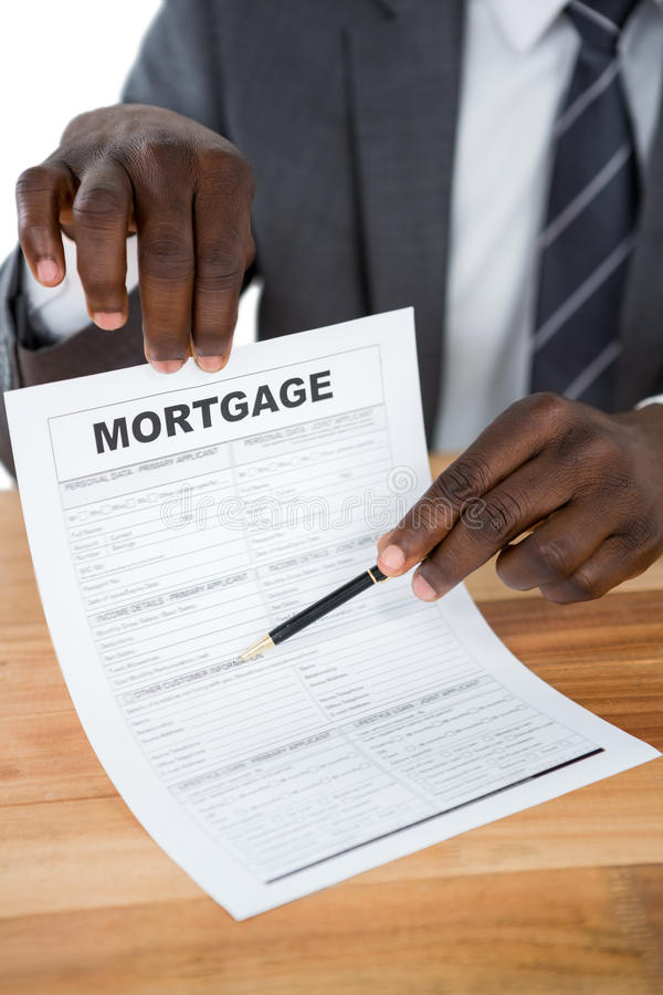Businessman showing mortgage document stock images