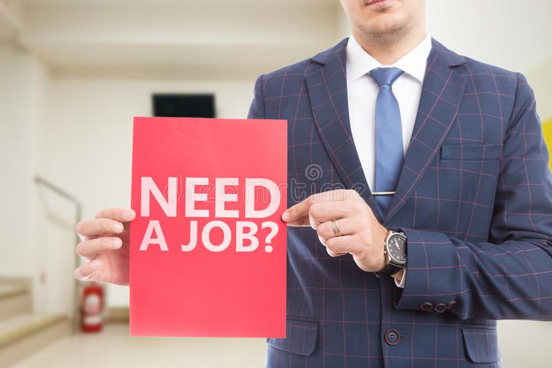 Businessman showing need a job question royalty free stock image