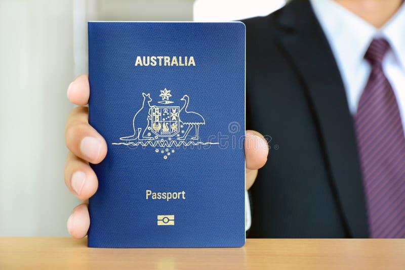 Businessman showing passport royalty free stock photos