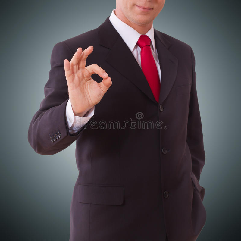 Businessman showing perfect gesture. Hand sign excellent, good, great, okay, yes. Businessman showing perfect gesture hand sign excellent, good great okay yes stock photography
