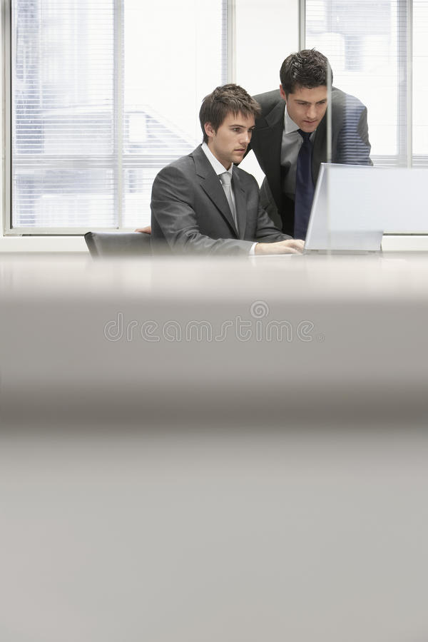 Businessman Showing Project To Colleague On Laptop stock images