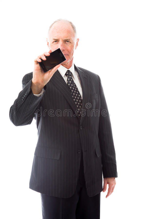 Businessman showing a smart phone. Senior man in his 60's shot in studio isolated on a white background stock images