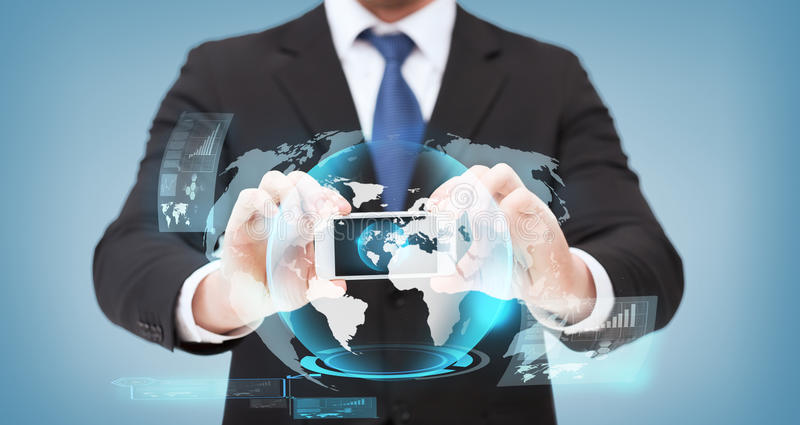 Businessman showing smartphone with globe hologram. Business, internet and technology concept - businessman showing smartphone with globe hologram on scree royalty free stock photo