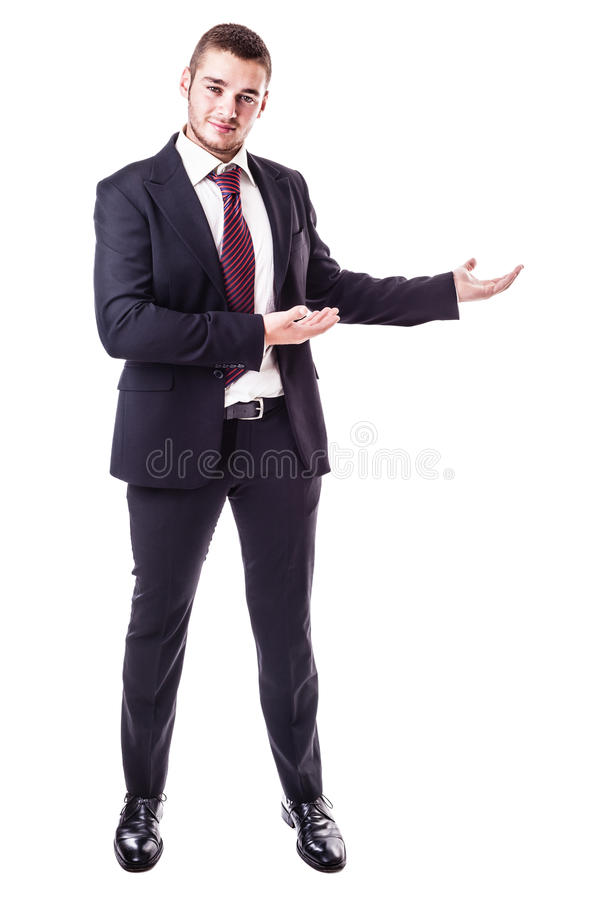 Businessman showing something. A young businessman showing something isolated over a white background stock images