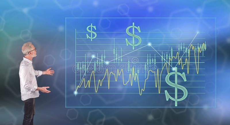 A stock exchange concept explained by a businessman on a wall screen. Businessman showing a stock exchange concept on a wall screen royalty free stock photography