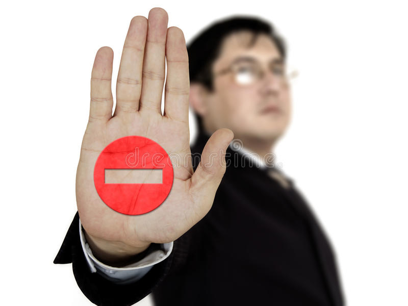 Businessman showing stop. Businessman raising his hand and showing stop royalty free stock photos