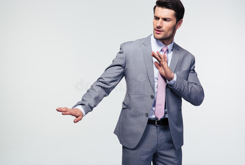 Businessman showing stop gesture stock images