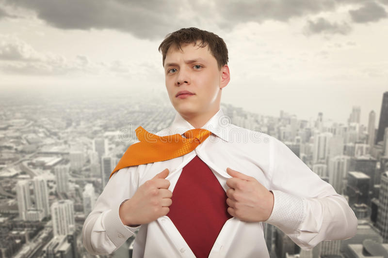Businessman showing the superhero suit royalty free stock images