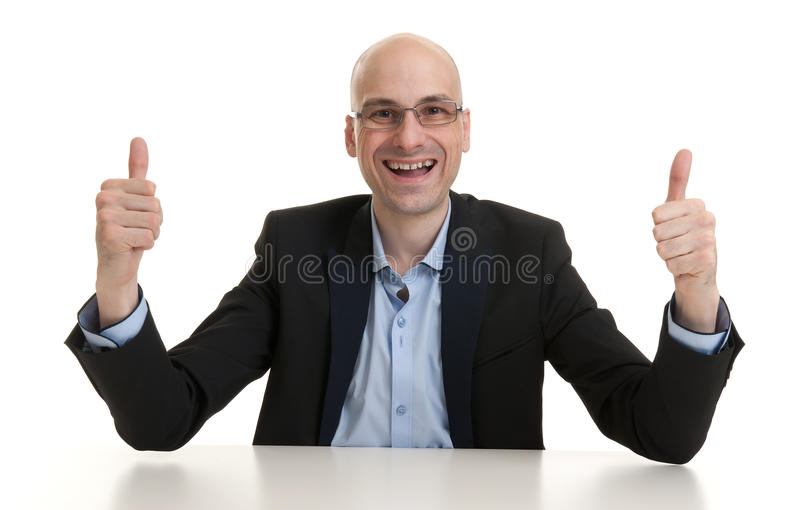 Businessman showing thumb up gesture stock photo
