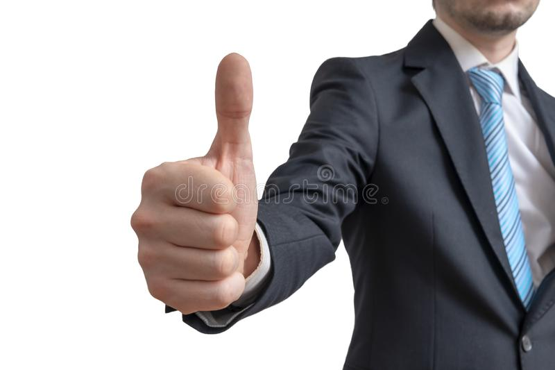 Businessman is showing thumbs up gesture. Isolated on white background.  royalty free stock images