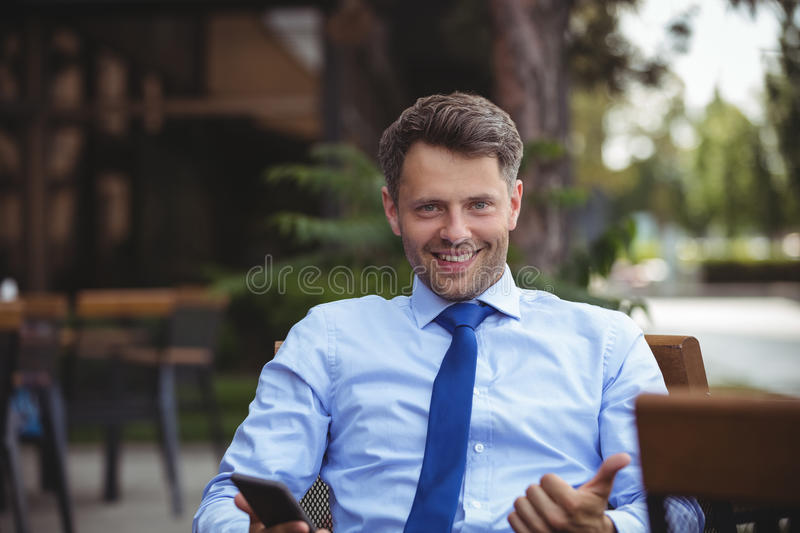 Businessman showing thumbs up stock image