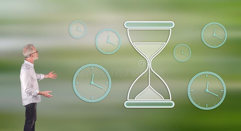 A time management concept explained by a businessman on a wall screen. Businessman showing a time management concept on a wall screen stock illustration