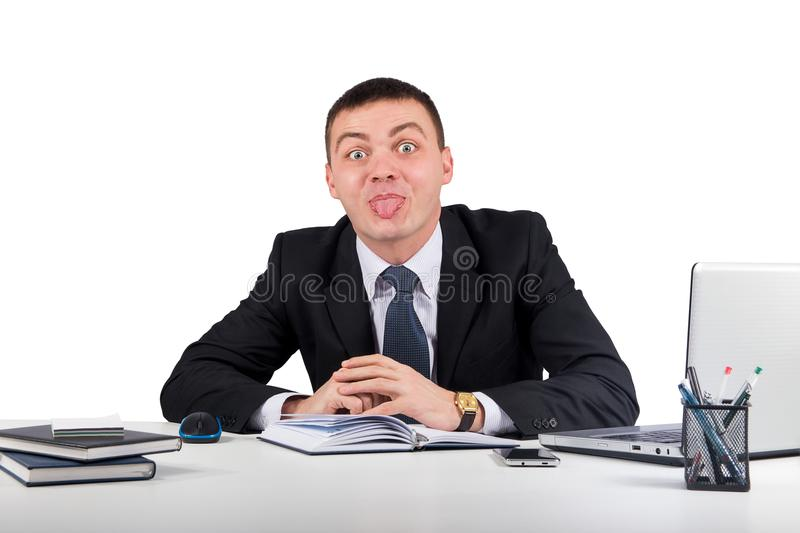 Businessman showing tongue isolated on white background. Office, finances, internet, business, success concept-Businessman showing tongue isolated on white royalty free stock images