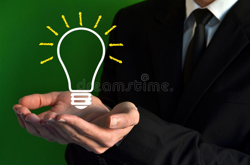 Businessman showing a virtual bulb symbol stock photo
